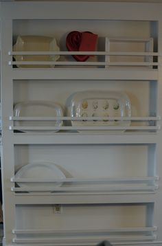 built-in plate/platter rack- maybe use for cutting boards in pantry?