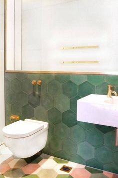 15+ Stylish Bathroom Tile Patterns | Domino - love the variations in the green tiles