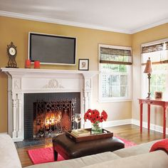 A fresh coat of paint on the fireplace and simple crown molding transformed this once dilapidated and disjointed living room. | Photo: Mark Lohman | thisoldhouse.com