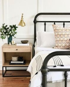 modern farmhouse master bedroom with iron bed and farmhouse bedding, nightstand decor with brass sconce, nightstand styling and neutral bedroom decor, rustic bedroom design Design Room, Master Bedroom Design, Home Decor Bedroom, Interior Design, Bedroom Ideas, Bedroom Designs, Bedroom Wall Lamps, Bedroom Lighting, Diy Bedroom