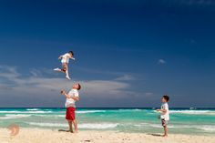 Dynamic family portrait taken at Beach Palace Resort in Cancun, Mexico during a family photo session by #DreamArtPhotography.