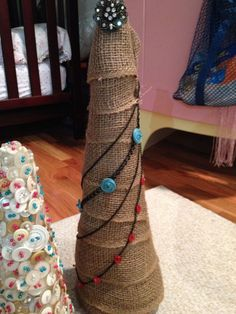 30 Magnificent DIY Christmas Trees. I like the garland on this. I know you can buy bags of single color buttons. Might have to try this!