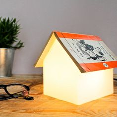 Just add your favourite book to the Book Rest bedside lamp! Read your favourite fairy-tale, horror story or glamour model biography to the warm glow of this clever and uncomplicated Book Rest Lamp.