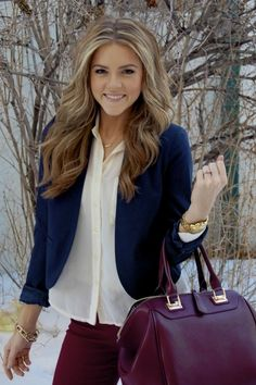white sheer button up, blue blazer, maroon jeans and handbag