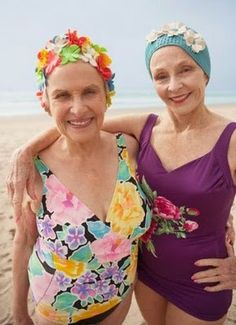 Cool ladies in floral swimsuits and swimmiing caps