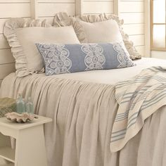 #PineConeHill | BEDROOM| Linen love! Pair our natural bedspread and ruffled shams with a classic striped throw and a detail-rich embroidered decorative pillow.