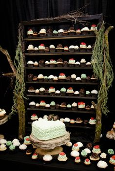 Cake table with wall of cupcakes - love