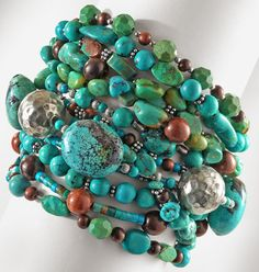 Love this look.  Time to make a multi-strand from my random beads...