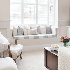 beautiful shutters and window seat