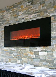 Electric Fireplace - Wall hung w/ realistic glowing embers.