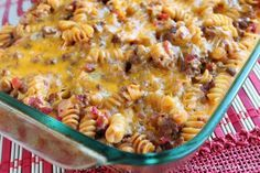 ingredients  2 cups (6 oz) uncooked rotini pasta (use brown rice pasta for GF) 2 tsp olive oil 1 1/2 cups onions, finely chopped 1 garlic clove, finely chopped 1 lb lean ground beef (95% lean) 3/4 tsp salt 1/2 tsp black pepper 2 tbsp tomato paste 28 oz diced tomatoes 2 tbsp Dijon Mustard 2 cups reduced-fat grated cheddar cheese 1/4 cup chopped dill pickles  Directions: Preheatthe oven to 350 degrees.Spraya 9 x 13 inch baking dish with cooking spray. In a large pot of boiling salted…