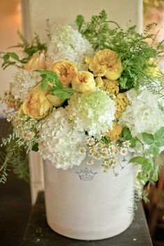 Like the colors, crock, hydrangeas, tiny daisies