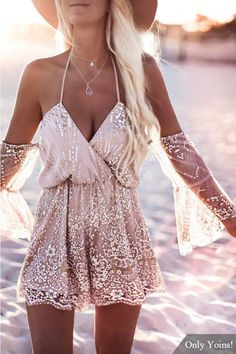 Bring attention to this mini playsuit. There are two ways to wear this fashion playsuit which is combined with halter and off the shoulder design. It is adorned with off shoulder, long sleeves and shimmer design. Pair with high heels will be great.