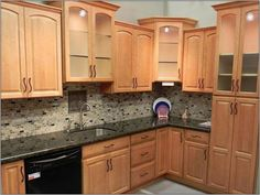 Kitchen Colors With Oak Cabinets honey oak kitchen cabinets with black countertops | top of the