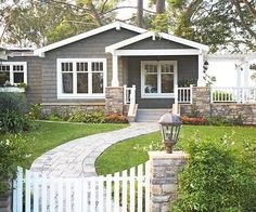Ranch with Curb Appeal- This gives me ideas of how to update the facade of our potential house: three color scheme, natural materials, using a gable to create a front porch and adding a side arbor.