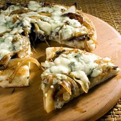 Caramelized Onion and Gorgonzola Pizza. Turned out super yummy, wish we had more! Used blue cheese instead (had it on hand) but not as much due to its potency. So I added a small amount of mozzarella and Parmesan, as well as sautéed mushrooms. Made a sweet balsamic glaze and drizzled it on top! Can't wait to make it again!