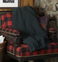 Red and black buffalo check upholstered chair with black cable knit throw  -  love it this tartan armchair! Get the Scottish highlander cabin look.