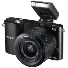 Buy & Experience features of Samsung Mirrorless Wi-Fi Digital Camera with Lens available for just from Tip Top Electronics UK with fast shipping. Camcorder, Camera Deals, Video Capture, Camera Settings, Zoom Lens, Fujifilm Instax Mini, Hd 1080p, Wi Fi, Chic
