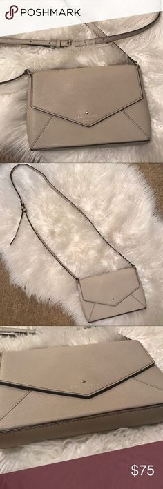 Kate spade Crossbody purse envelope clutch grey Grey smooth leather gently used purse. The perfect neutral that's lift and matches all browns and blacks. Holds a mini wallet, phone, lipstick and a few other small items if you'd like. A little dirt on inside kate spade Bags Crossbody Bags