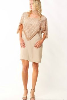 96% Polyester 04% Elastane Crochet detail 100% Cotton let your look sore above the clouds with butterfly with the Pala Dress! A layer of crochet falls from a V-
