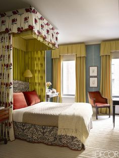 A canopy bed presides over the master bedroom of a New York City townhouse that aces both vibrant color and eclectic charm