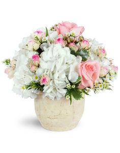 This lovely, delicate arrangement is a perfect way to send gentle thoughts of affection.   White hydrangea and light pink roses, mixed with precious pink spray roses, create an enchanting display in a stone pot.