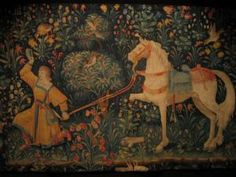 St. Eligius, a Patron Saint of Horses: A French tapestry of the famous story of Saint Eligius shoeing a horse by miraculously removing and then reattaching the horse's leg