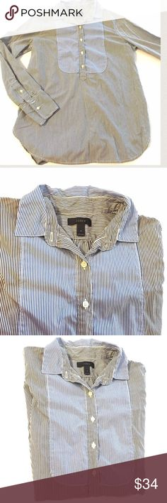 "J. Crew Blue Pinstriped Popover Size 2 J. Crew shirt with buttons halfway down the front.  Contrasting pinstripes.  Shirttail hem.  100% cotton.  Armpit to armpit 20"" length 27"" Size 2 J. Crew Tops Button Down Shirts"