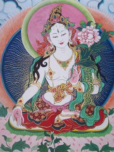 It's the Tibetan syllable TAM, the seed syllable of the female buddha Tara (sanskrit) or Dölma (tibetan), which translates as Liberatress. As it is white here, it stands for the White Tara, which especially gives the blessings for a long life: