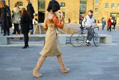street style: London Fashion Week Fall 2014 (Burberry Prorsum coat)...