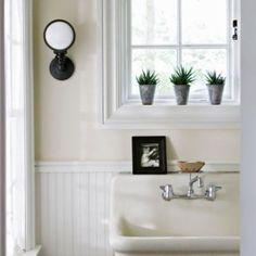 We're lusting after the deep vintage sink in this bath and the retro sconce. As seen on AllYou.com