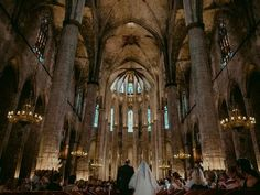 Dark academia gothic church wedding with cathedral ceilings and chandeliers