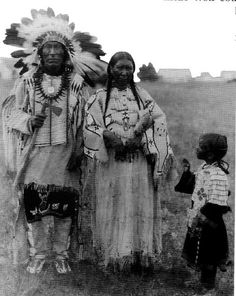 Native American Encyclopedia .  Iron Hail (aka Dewey Beard) with his 2nd wife Alice Beard and granddaughter Celane Marie Beard - Mniconjou - 1920