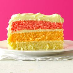 Rainbow Layer Cake | Taste of Home - this recipe uses a few Tb of Kool-Aid mix (lemon, orange & strawberry), boxed white cake and lemon frosting.  Easy peasy.  Make in a heart-shaped pan for Valentine's Day