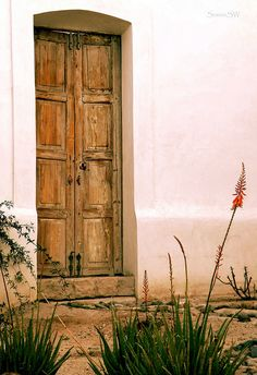 An old door in the El Presidio Historic District, Tucson, Arizona - By: ScenicSW