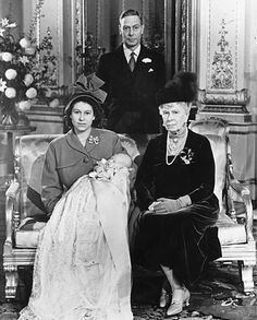 4 generations:  George VI, his mother Queen Mary, his daughter Princess Elizabeth holding Prince Charles at his christening.