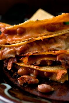 NYT Cooking: These quesadillas have little in common with fast-food varieties, which are made with flour tortillas and a lot more cheese. A Taco Bell cheese quesadilla has 480 calories and milligrams of sodium Taco Bell Cheese Quesadilla, Nachos, Quesadillas, Vegetarian Entrees, Vegetarian Mexican, Fast Food, Recipe 30, Baked Beans, Quick Meals