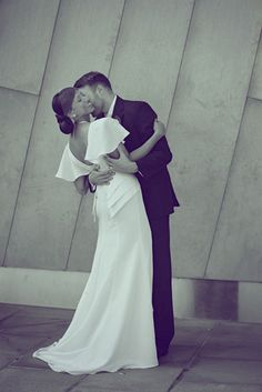 Wedding photo pose. Doesn't have to be this exactly, but the idea of this is really cute. Kiss on the neck, girl smiling big