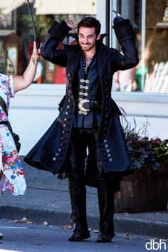 soooo here's colin being a dork. someone told him to give us a pirate ARRRRRG so he threw his hands up and was like ARRRRRR. so cute ;__;