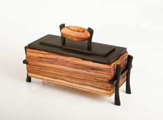 Fine woodworking and wooden sculpture by Dan Southern at wooden addictions, featuring Primitive art sculpture, contemporary art, zen gardens, and jewelry boxes.