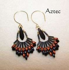 Some earrings are so hot they need to fan you down.  Enjoy this awesome fan shaped earring with it's Aztec style touch.  With it's dark blues, copper and black with hints of gold.  They are a pleasure to have.   Handmade with professional quality beading thread and beads. #scottsmarketplace