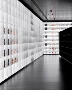 iksoi design studio creates monochromatic interior for liquor store in india Booth Design, Wall Design, Modern Interior Design, Interior Architecture, Store Interior Design, Liquor Shop, Modern Store, Visual Merchandising, Store Interiors