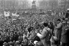 Canon John Collins of St. Paul's Cathedral, a leading figure in the campaign for nuclear disarmament which organized the two ban-the-bomb marches over the Easter holiday, addresses a mass protest rally in London's Trafalgar Square on April 3, 1961, after the marchers had converged on central London from Aldermaston and Wethersfield.