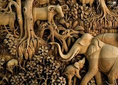 Highly detailed Thai wood carving of wildlife.