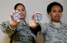 Master Sgt.Nora Castro & Tech.Sgt.Carolyn Tatum, 136th Airlift Wing, exas Air National Guard,show off coin they received from Lt.Gen. Stanley Clarke during his site visit at Naval Air Station Fort Worth Joint Reserve Base,Aug.21,2013.Lt.Gen. Clarke awarded coins for serving with distinction.(Air NG Airman Cody Witsaman)Used to have something similar from the F-15 Groups from RAF Mildenhall,bought at airshow at North Weald,near London.