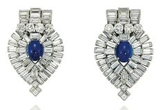 A PAIR OF ART DECO SAPPHIRE AND DIAMOND CLIP BROOCHES Of inverted shield shape, each panel with central sapphire cabochon to a radiating baguette-cut diamond stepped surround and similarly-set curved three line surmount, with brilliant-cut diamond four stone highlight, circa 1930, French import marks for platinum, 5.3cm long