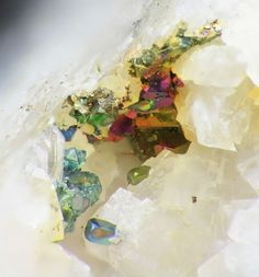 Iridescent chalcopyrite on dolomite.  I had a dream about a white cave with brilliant jewels in the wall when I was in my mid teens.  It looked like this.