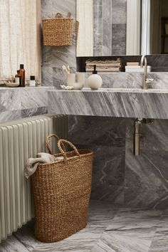 Handmade laundry basket by H&M Home.  Minimal marble bathroom in neutral colours. Bathroom of dreams!   #bathroominspiration #minimaldesign