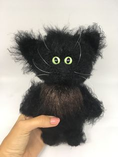 Our amigurumi custom cat portrait is made with fluffy yarn that is almost as soft as real fur. With moveable front paws, big eyes, and brushable fur, this fluffy kitty cat would make the perfect gift for a cat lover, whether that's you or a friend.