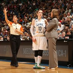 Point guard Lindsay Whalen chats with head coach Cheryl Reeve during the home opener on 06/01/13 (Photo credit: David Sherman/NBAE/Getty Images)